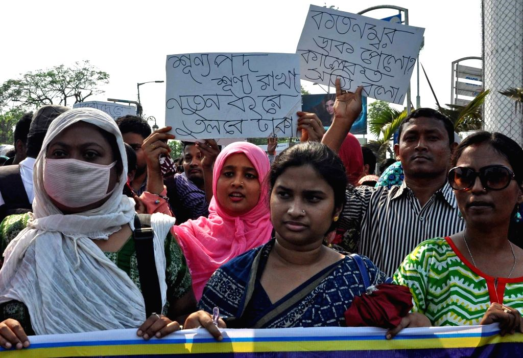 Job aspirants along with the activists of Students' Federation of India (SFI) and Democratic Youth Federation of India (DYFI), during a demonstration organised to press for their various ...