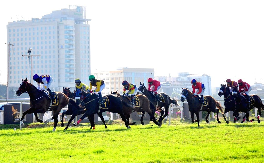 Jockeys ride horses during the Kingfisher Ultra Derby 2021 at Race Course, in Bengaluru on Tuesday 26th January 2021