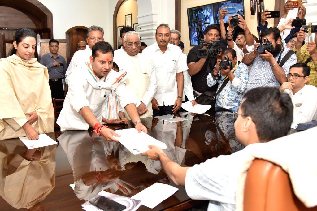 Jodhpur: Congress leader Vaibhav Gehlot, son of Rajasthan Chief Minister Ashok Gehlot files his nomination from Jodhpur Lok Sabha constituency, ahead of the 2019 Lok Sabha polls, in Jodhpur, on April 9, 2019. (Photo: IANS) - Ashok Gehlot