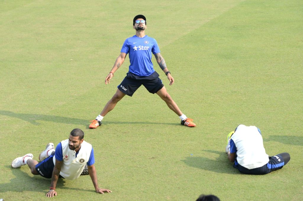 : Jodhpur: Mohali: Indian cricketers Virat Kohli and Shikhar Dhawan during a practice session ahead of the 1st Test match between India and South Africa in Mohali on Nov. 4, 2015. (Photo: IANS).