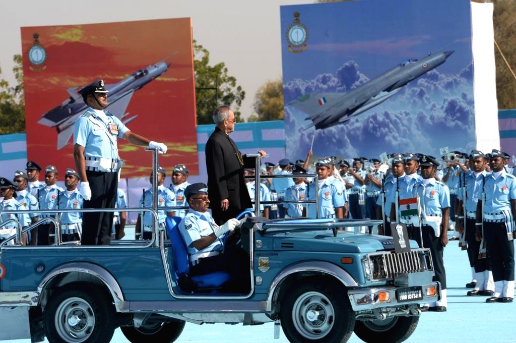 President Pranab Mukherjee inspects guard of honour during a programme organised to present the presidential standards to 21 SQN and 116 HU of Indian Air Force in Jodhpur, on March 4, 2015. - Pranab Mukherjee