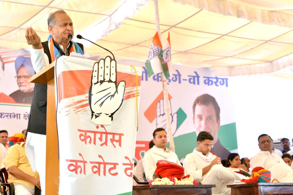 Jodhpur: Rajasthan Chief Minister Ashok Gehlot addresses during a public rally in Jodhpur, on April 9, 2019. Also seen Rajasthan Chief Minister Ashok Gehlot's son and Congress' Lok Sabha candidate from Jodhpur, Vaibhav Gehlot and Rajasthan Deputy Chi - Ashok Gehlot