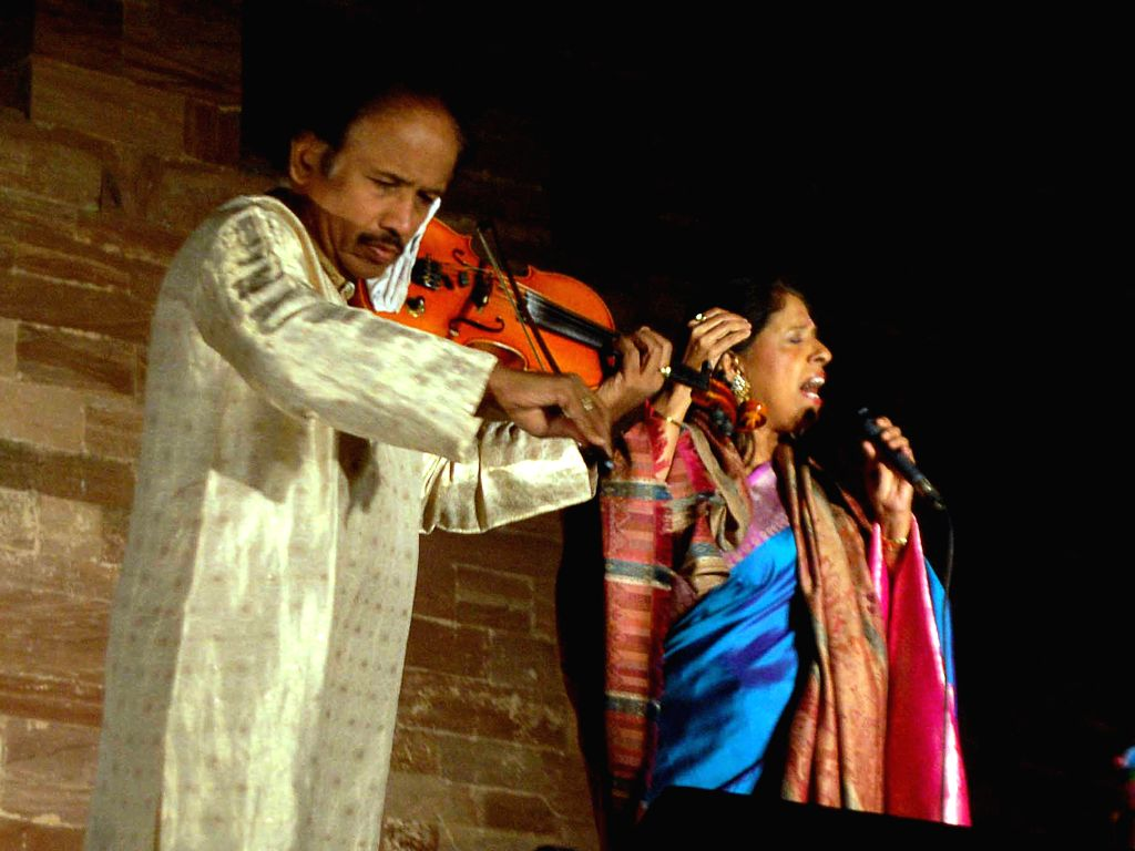 Singer Kavita Krishnamurthy performs with her husband and acclaimed violinist Dr. Lakshminarayana Subramaniam during a programme organised at Mehrangarh Fort in Jodhpur, on March 1, 2015.
