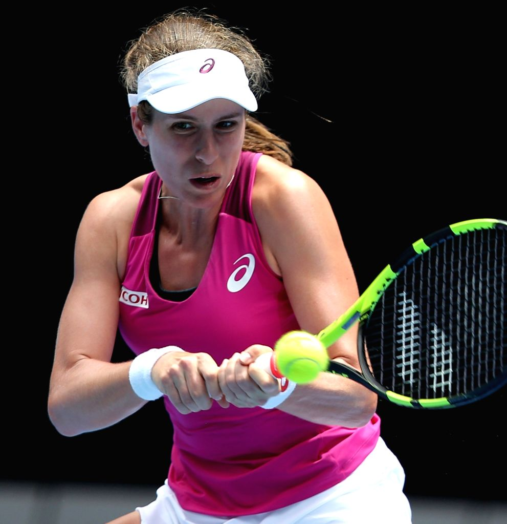 Johanna Konta of Great Britain returns the ball against Venus Williams of the United States during the first round match of women's singles at the Australian Open ...