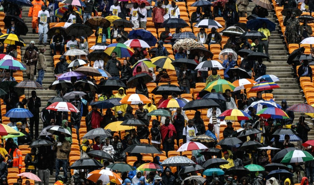 People attend the memorial service for Nelson Mandela in Johannesburg, South Africa, on Dec. 10, 2013. Memorial service for former South African president