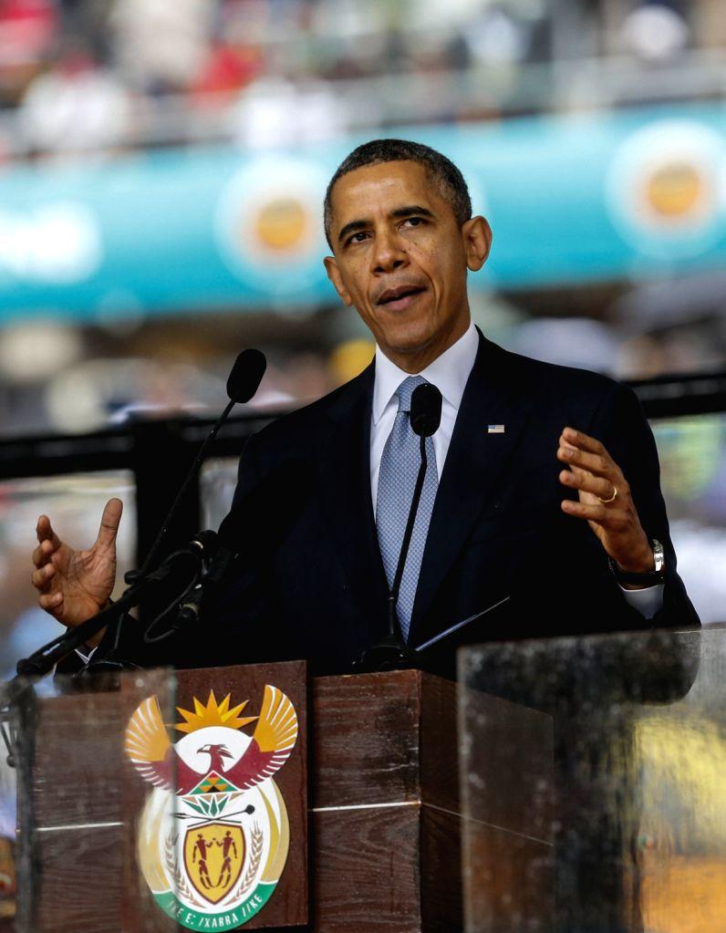 U.S. President Barack Obama speaks during the memorial service for Nelson Mandela in Johannesburg, South Africa, on Dec. 10, 2013. Memorial service for ...
