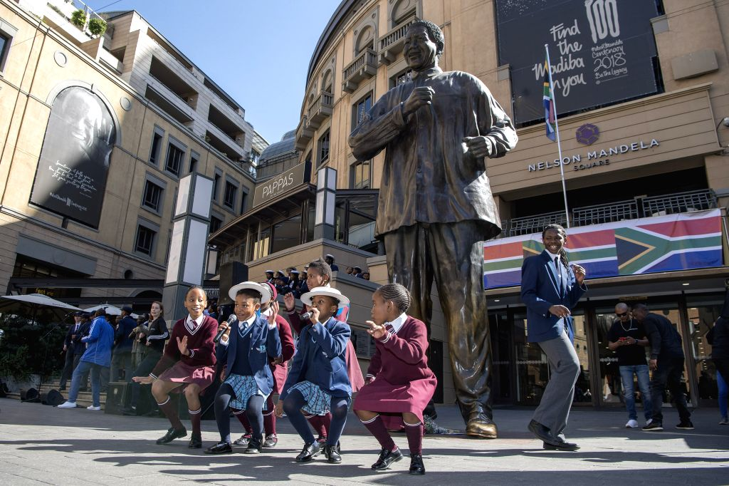 JOHANNESBURG, July 18, 2019 - Pupils sing and dance at the Nelson Mandela Square to mark the Nelson Mandela Day, in Johannesburg, South Africa, July 18, 2019. South Africans celebrate the 10th ...