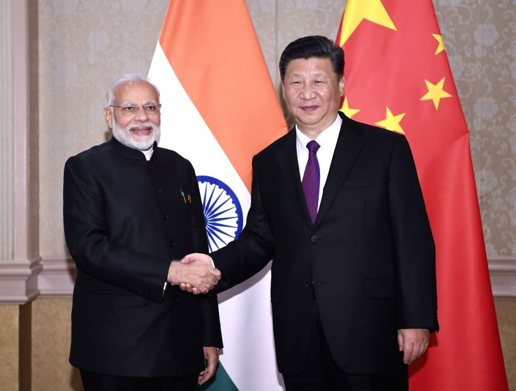 JOHANNESBURG, July 26, 2018 - Chinese President Xi Jinping (R) meets with Indian Prime Minister Narendra Modi in Johannesburg, South Africa, July 26, 2018. - Narendra Modi