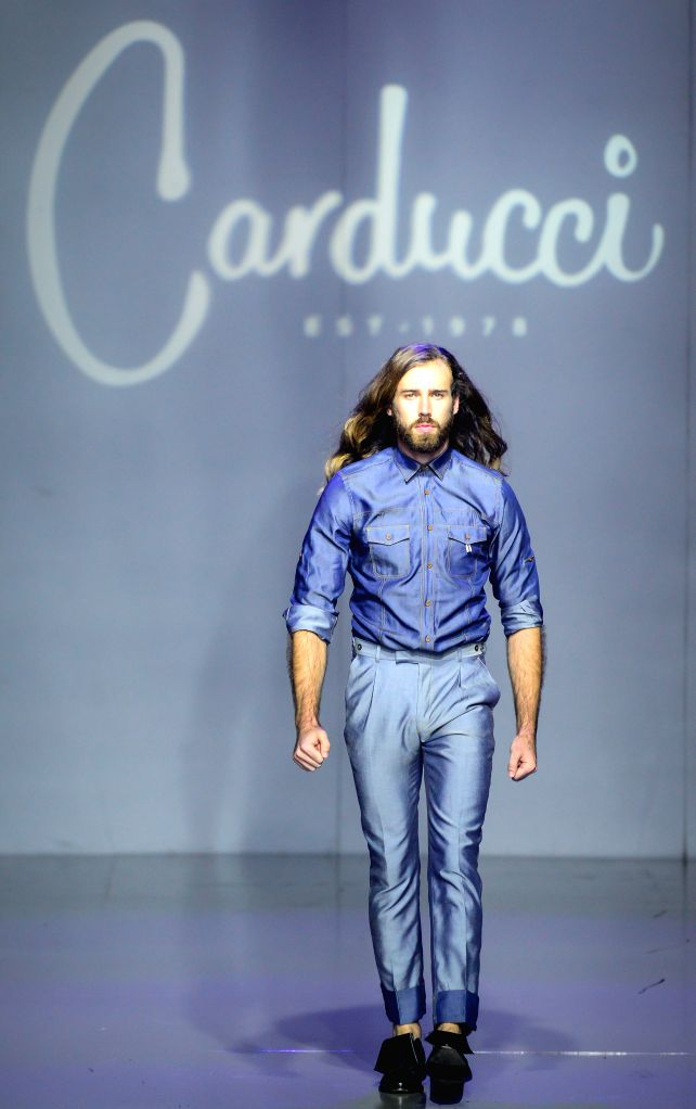 JOHANNESBURG, March 12, 2016 - A model presents a creation from local brand CARDUCCI on the third day of Mercedes-Benz Fashion Week Joburg 2016 at Nelson Mandela Square in Johannesburg, South Africa ...