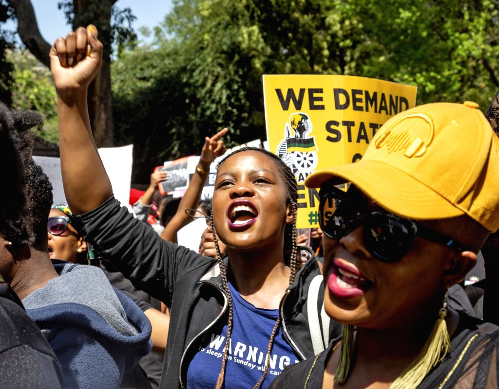 JOHANNESBURG, Sept. 13, 2019 - People take part in a protest against gender violence in Johannesburg, South Africa, Sept. 13, 2019. Thousands of people hit the main streets in Sandton, Johannesburg ...