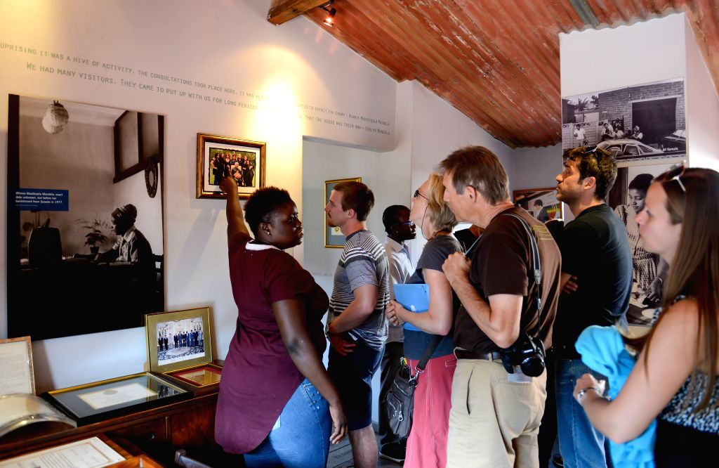 Johannesburg (South Africa): Visitors look at the display items at the Nelson Mandela National Museum in Soweto, southwest of Johannesburg, South Africa, on Dec. 4, 2014. The Nelson Mandela National .