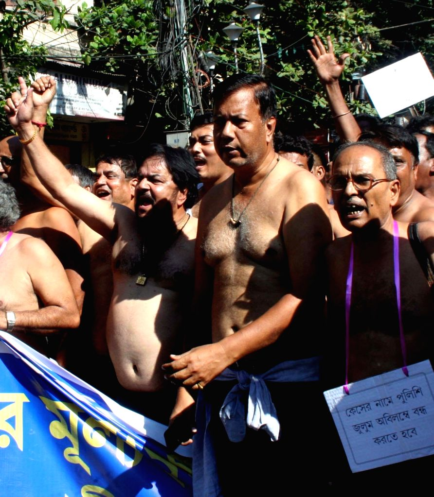 Joint Council of Bus Syndicate members take out a rally demanding transport fare price hike due to fuel price hike in Kolkata on Nov. 1, 2018.