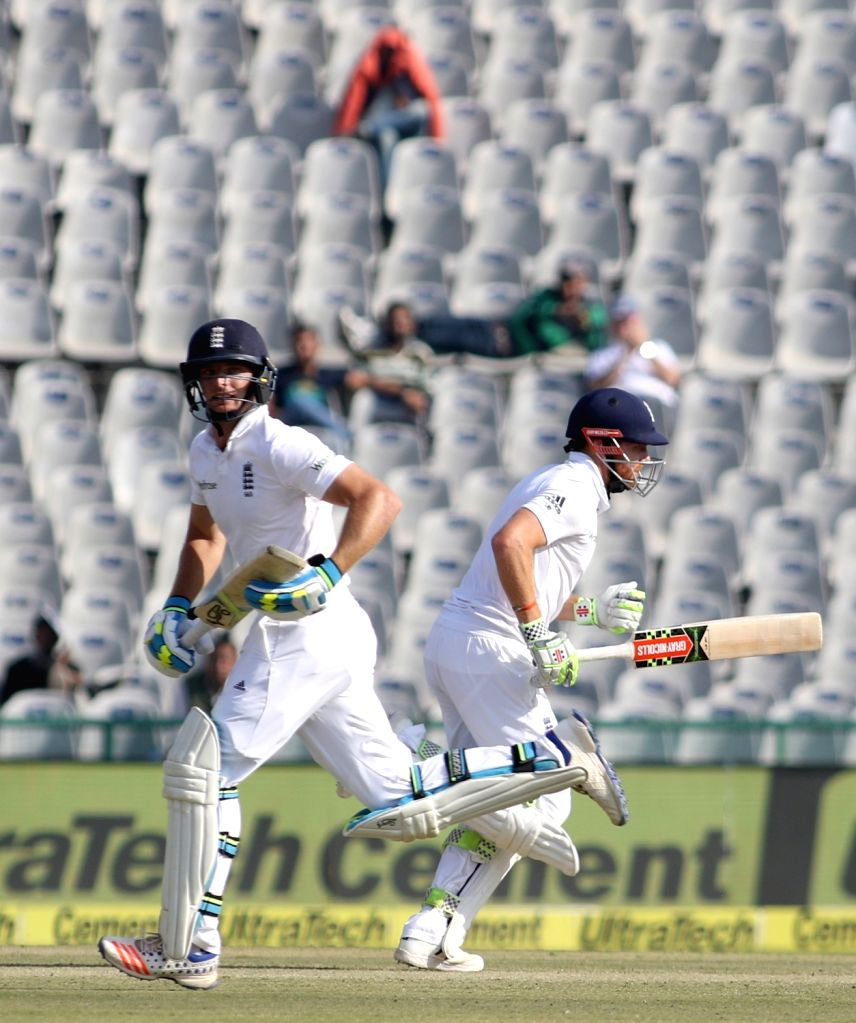 Jonathan Bairstow and Jos Buttler of England in action during the third test match between India and England at Punjab Cricket Association IS Bindra Stadium in Mohali on Nov 26, 2016. (Photo: ... - Surjeet Yadav