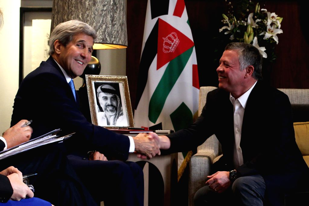 Jordan King Abdullah II (R) meets with U.S. Secretary of State John Kerry at the Royal Palace in Amman, Jordan, Oct. 24, 2015.