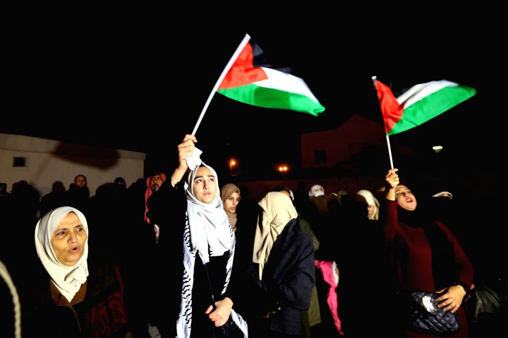 Jordanians take part in a protest in Amman, Jordan, on Jan. 28, 2020. Dozens of Jordanians held a sit-in near the U.S. embassy in Amman on Tuesday night in protest of ... - Abu Ghosh