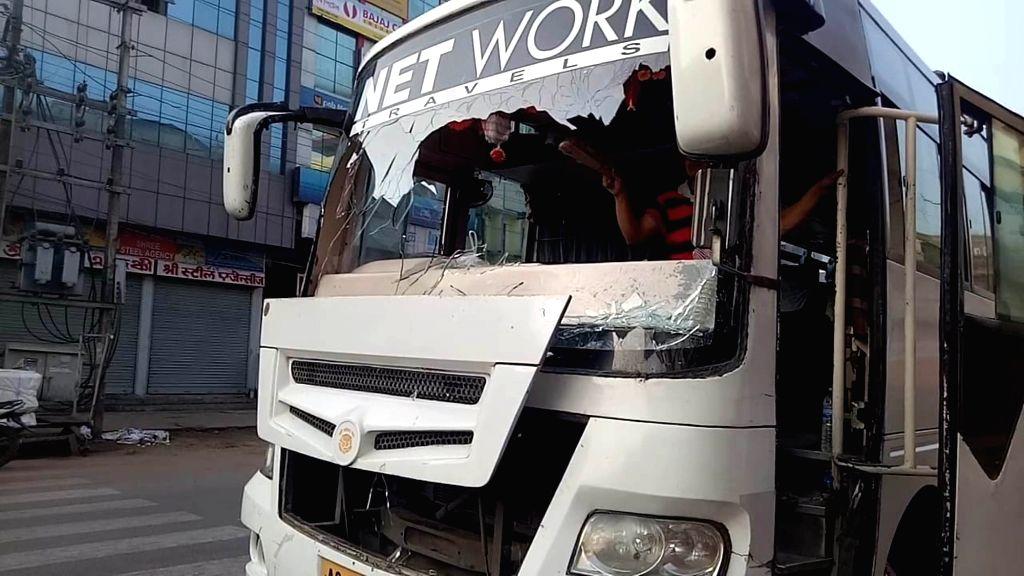 :Jorhat: Protesters damage a bus during a 12-hour Assam bandh called by the Krishak Mukti Sangram Samiti and Asom Jatiyatabadi Yuva Chatra Parishad (AJYCP) to protest against the Joint ...