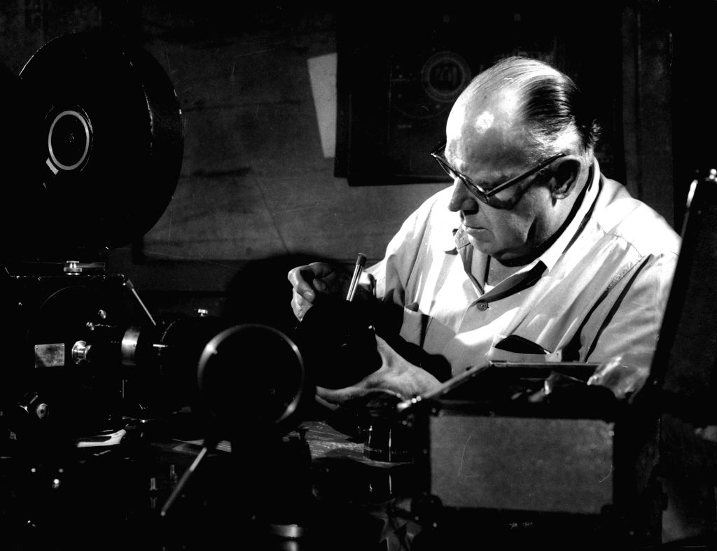 Josef Wirsching servicing his camera equipment at the Bombay Talkies studios early 1950's.