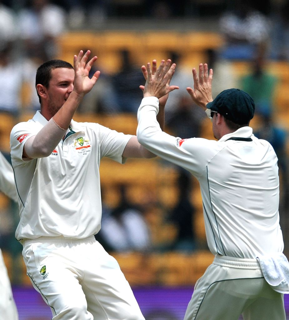 Josh Hazlewood of Australia celebrates fall of a wicket during the third day of the second test match between India and Australia at M. Chinnaswamy Stadium in Bengaluru on March 6, 2017.