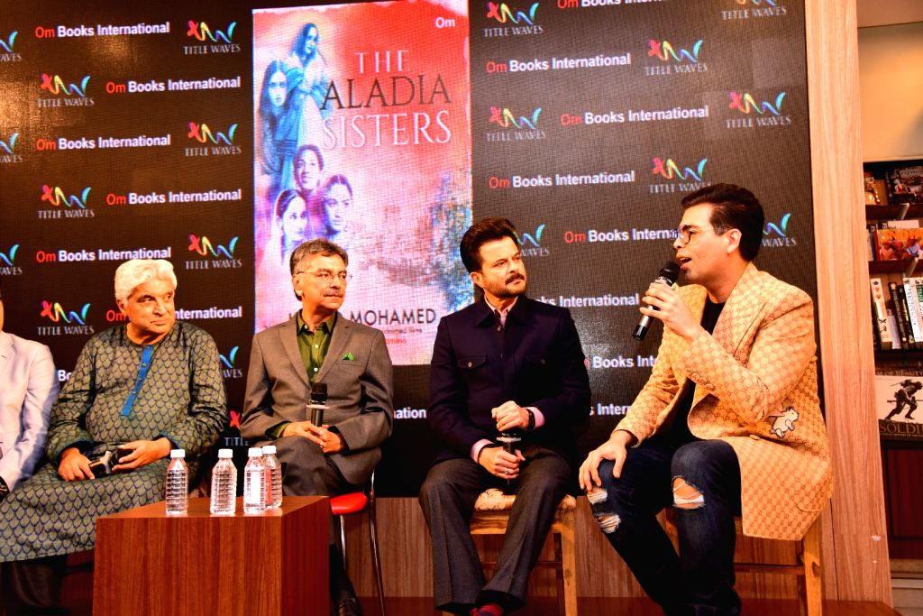 "Journalist and author Khalid Mohamed with filmmaker Karan Johar, poet, lyricist and screenwriter Javed Akhtar and actor Anil Kapoor at the launch of his book ""The Aladia Sisters"" in ... - Anil Kapoor and Karan Johar"