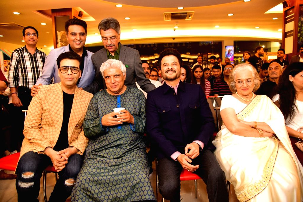 """Journalist and author Khalid Mohamed with filmmaker Karan Johar, poet, lyricist and screenwriter Javed Akhtar and actor Anil Kapoor at the launch of his book """"The Aladia Sisters"""" in ... - Anil Kapoor and Karan Johar"""