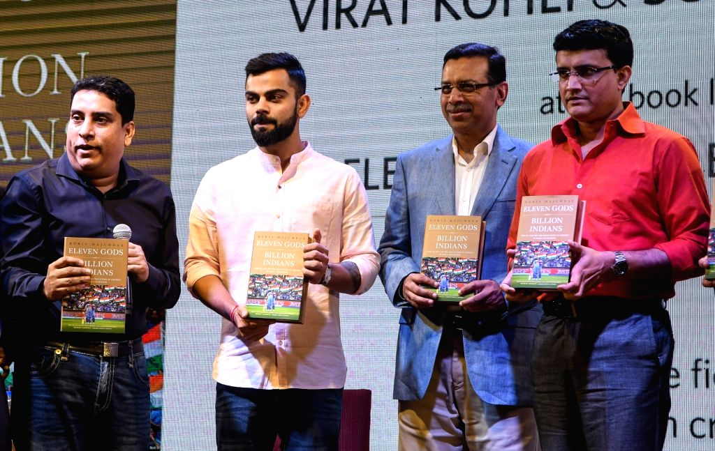 Journalist Boria Majumdar with Indian cricket team's captain Virat Kohli, Cricket Association of Bengal (CAB) President Sourav Ganguly and other dignitaries during the launch of his book ... - Virat Kohli and Sourav Ganguly