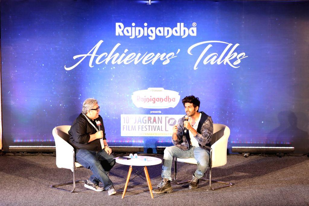 Journalist Rajeev Masand in conversation with actor Kartik Aryan on the second day of the 10th Jagran Film Festival in Mumbai on Sep 27, 2019. - Kartik Aryan