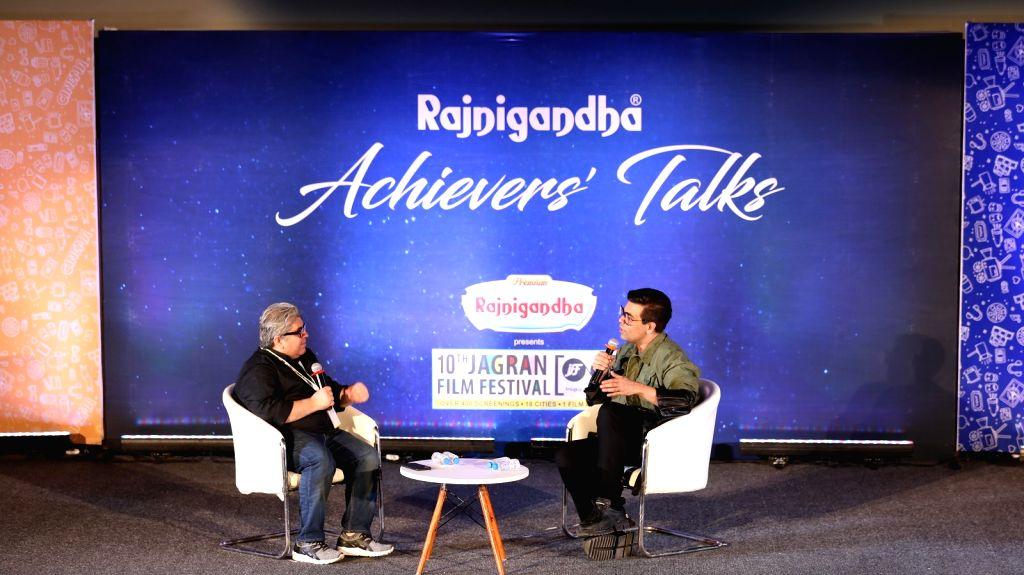 Journalist Rajeev Masand in conversation with filmmaker Karan Johar on the second day of the 10th Jagran Film Festival in Mumbai on Sep 27, 2019. - Karan Johar