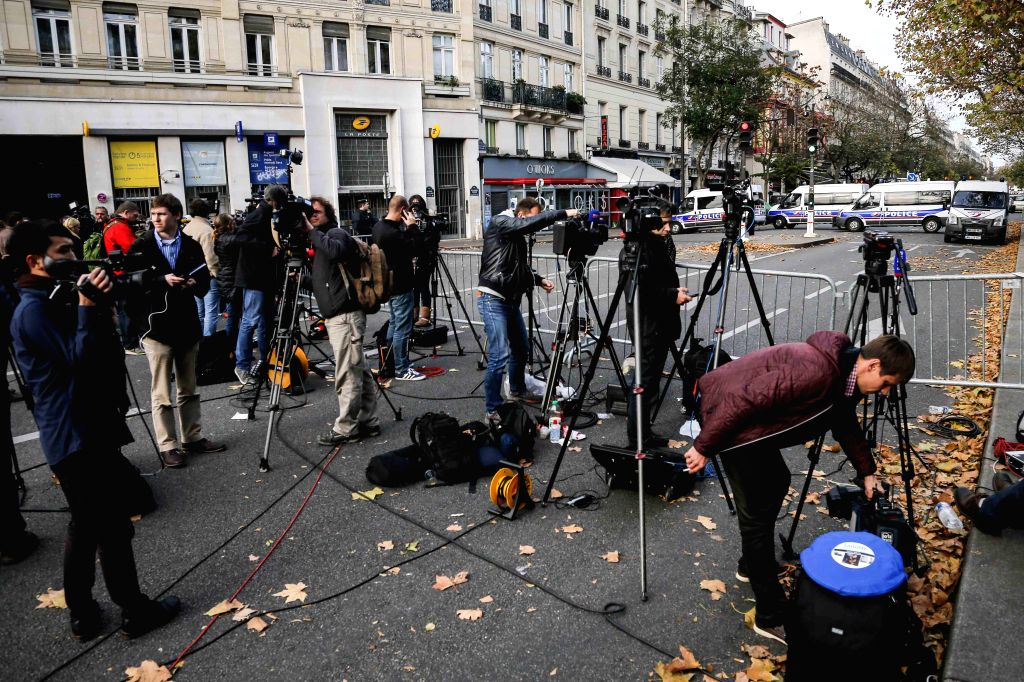 Journalists gather near the Bataclan concert hall in central Paris, France, Nov. 14, 2015. Over 100 people were killed in a mass hostage-taking at a Paris concert ...
