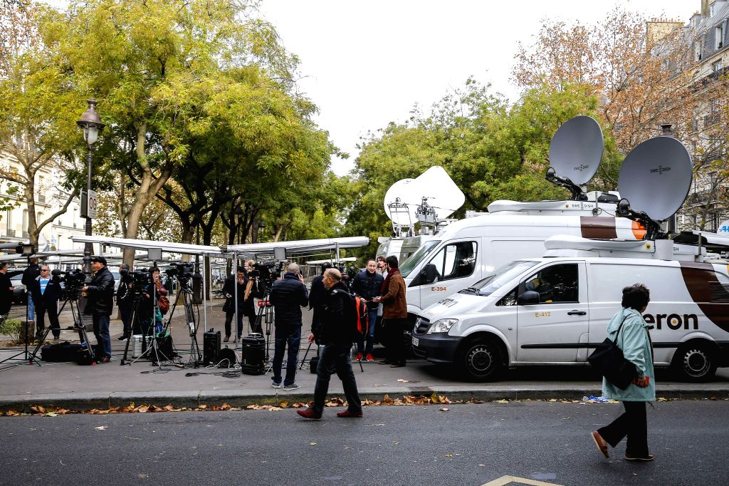 :Journalists gather near the Bataclan concert hall in central Paris, France, Nov. 14, 2015. Over 100 people were killed in a mass hostage-taking at a Paris concert ...