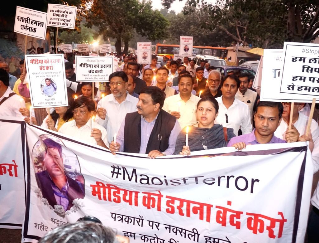 Journalists of Delhi participate in a protest candle march against the killing of a Cameraperson of DD News Achyutanand Sahu and 3 security personnel in a Naxal attack in Chhattisgarh on ...