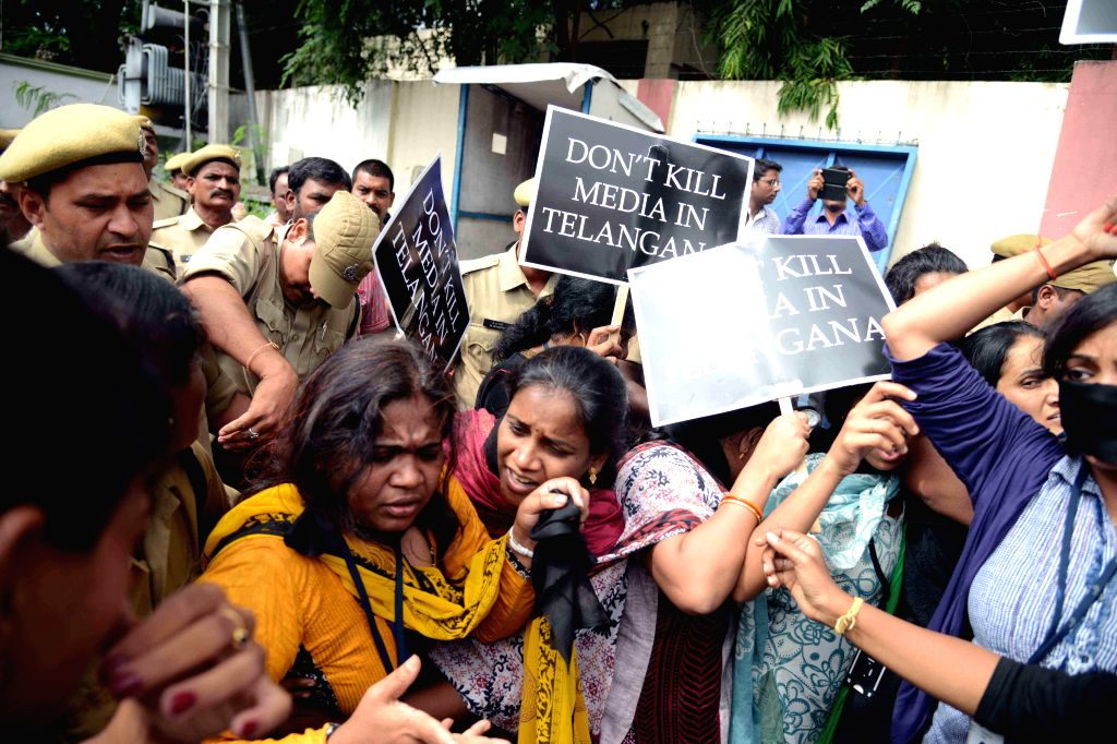 Journalists protest against black-out of two Telugu channels in Telangana, in Hyderabad on Sept 9, 2014.