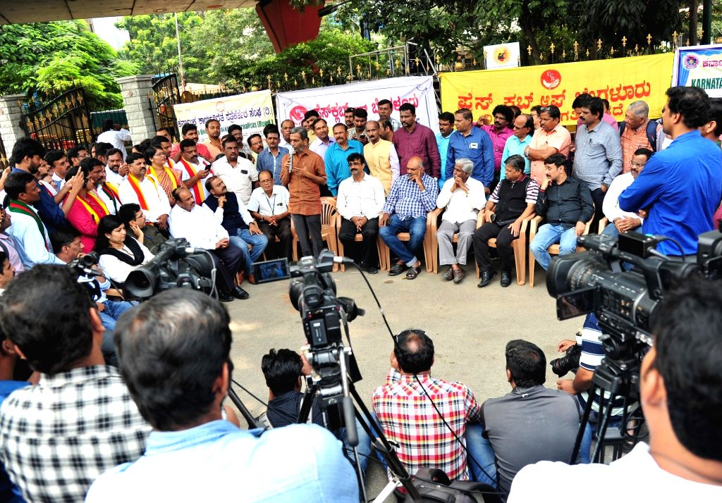 Journalists raise slogans during a protest by media personnel against the ban on camera persons from covering Karnataka assembly session, in Bengaluru on Oct 11, 2019.