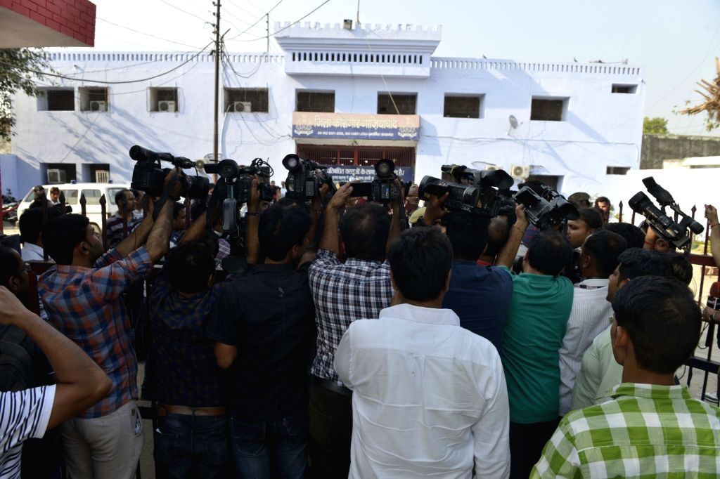 Journalists stand outside Dasna Jail where dentist couple Rajesh and Nupur Talwar, who were acquitted in the double murder of their daughter Aarushi and domestic help Hemraj in 2008 by the ...