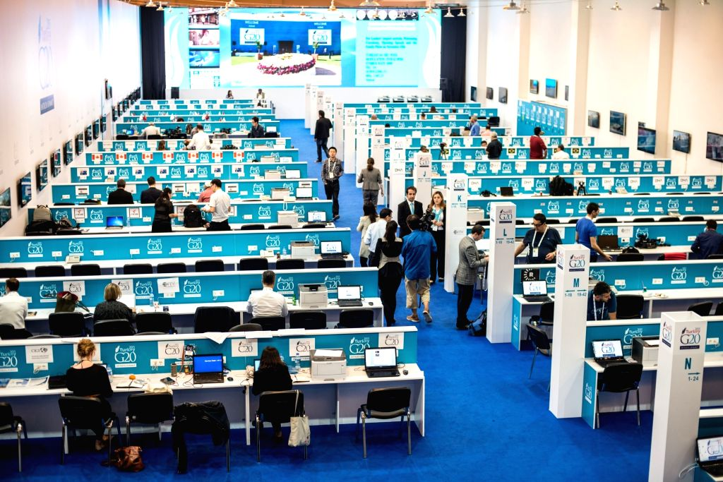 Journalists work at the main zone of the site of G20 Summit, which will be held from Nov. 15 to 16, in Antalya, a Mediterranean resort city of Turkey, on Nov. 13, ...