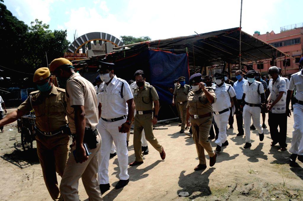 Jt. Commissioner of Police, Kolkata, Subhankar Sinha Sarkar paid an inspection visit to the Kumartuli park Durga Puja pandal along with his team ahead of Durga Puja celebrations, in Kolkata ... - Subhankar Sinha Sarkar