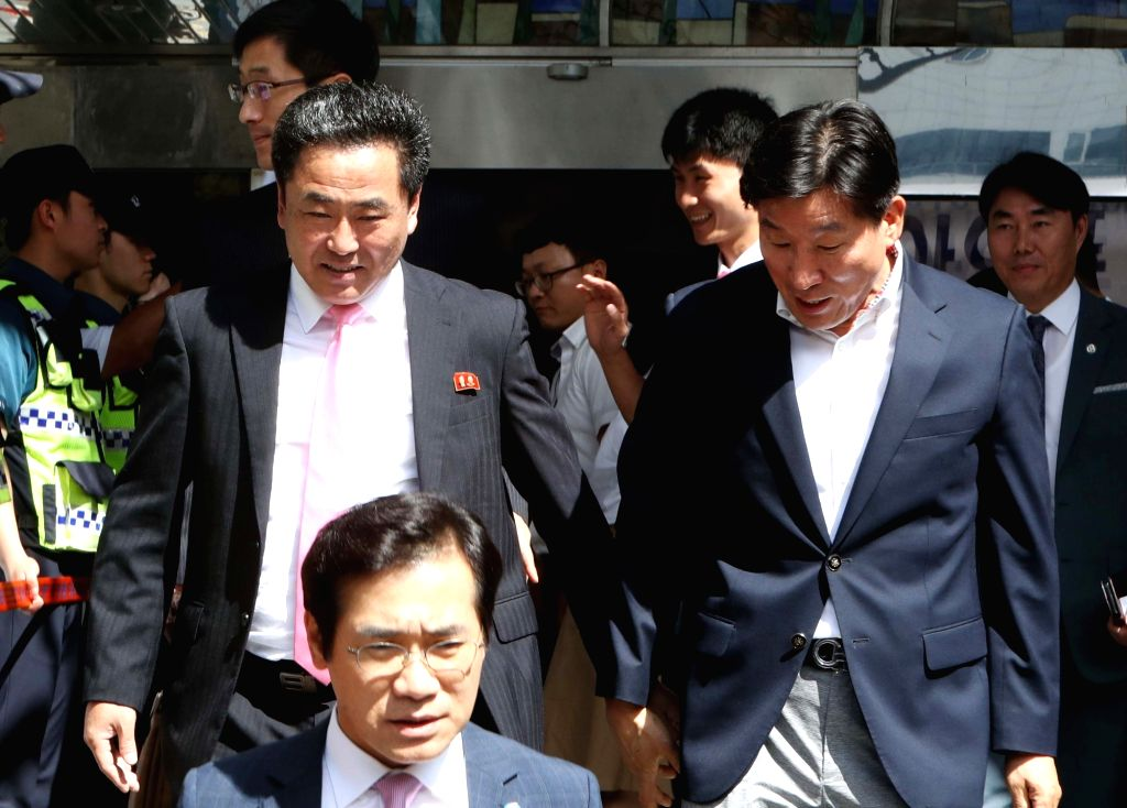 Ju Jong-chol (L), secretary general of the North Korean Table Tennis Association, heads out from Daejeon, 160 kilometers south of Seoul, to return home on July 23, 2018, after leading his ...