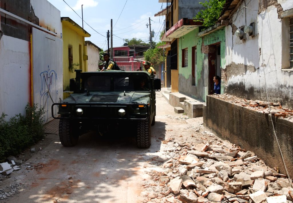 JUCHITAN (MEXICO), Sept. 10, 2017 A military vehicle inspects a street after an earthquake hit in Juchitan, Oaxaca state, Mexico, Sept. 9, 2017. A powerful earthquake measuring 8.2 on the ...