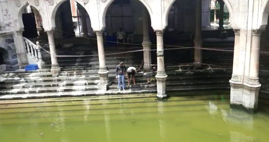 JUMA MASJID OF BOMBAY; The huge fish that live inside the pond have been removed to safety and will return to the pond by this weekend after the clean-up.