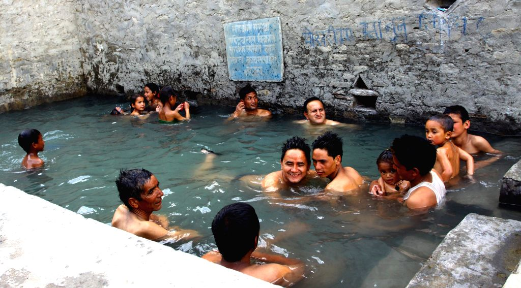 People bath at Tatopani (hot water) pond in Jumla of Karnali, Nepal May 7, 2014. Nepalese people believe that diseases will be recovered after taking bath in this ...
