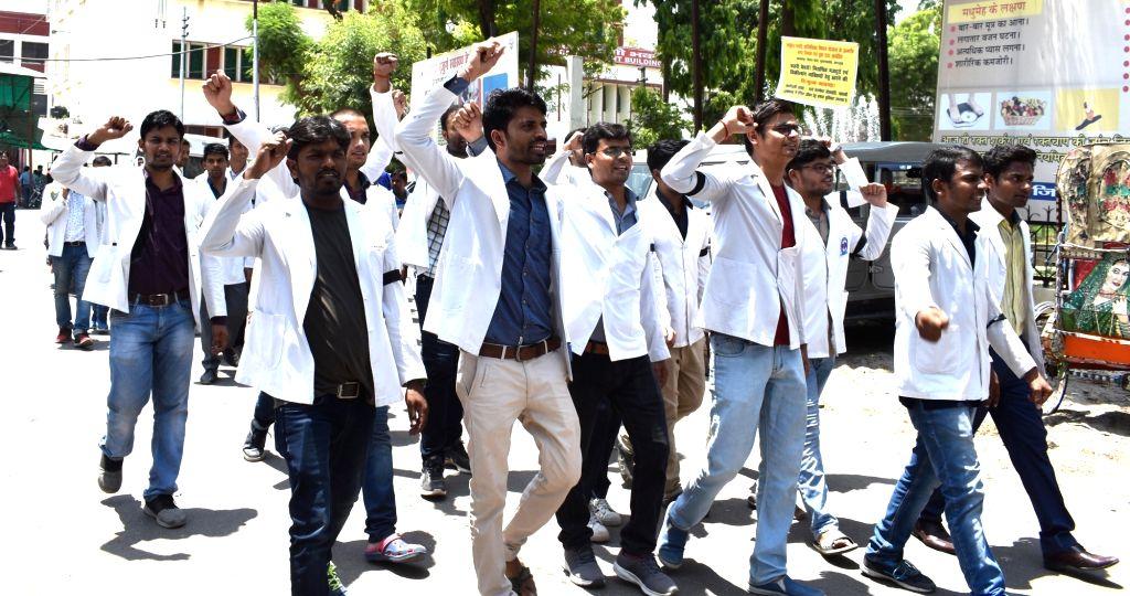 Junior doctors of Swaroop Rani Nehru (SRN) Hospital stage a demonstration against the assault on doctors at Kolkata's NRS Medical College and Hospital, in Prayagraj on June 14, 2019.