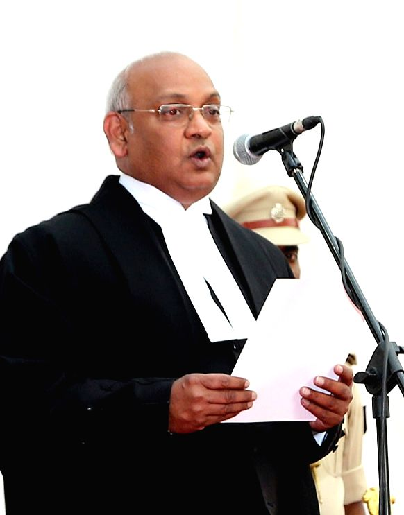 Justice Dinesh Maheshwari takes the oath of office as he is sworn in as the Chief Justice of Karnataka High Court in Bengaluru on Feb 12, 2018.