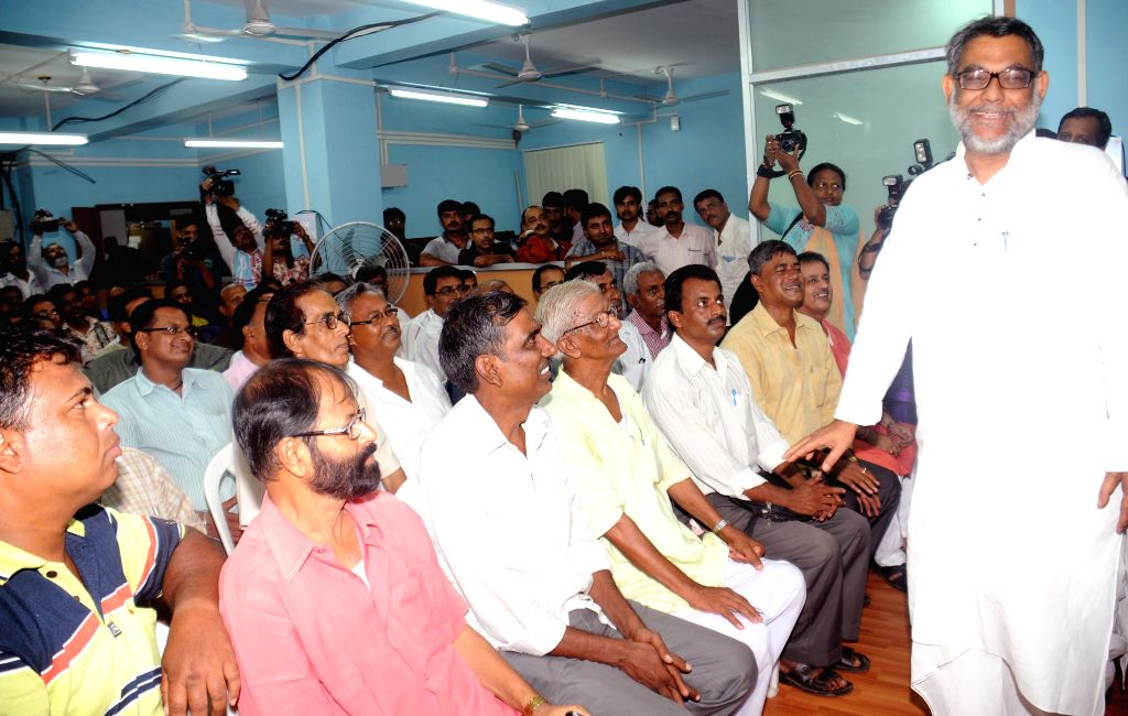Jute mill workers meets West Bengal Labour Minister Purnendu Bose after recent labour unrest in Kolkata on June 17, 2014.