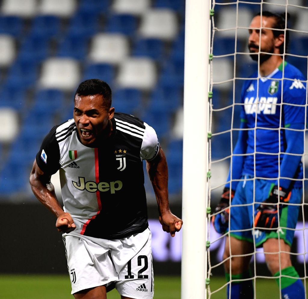 Juventus' Alex Sandro (L) celebrates after scoring during a Serie A football match between Sassuolo and Juventus in Reggio Emilia, Italy, July 15, 2020.