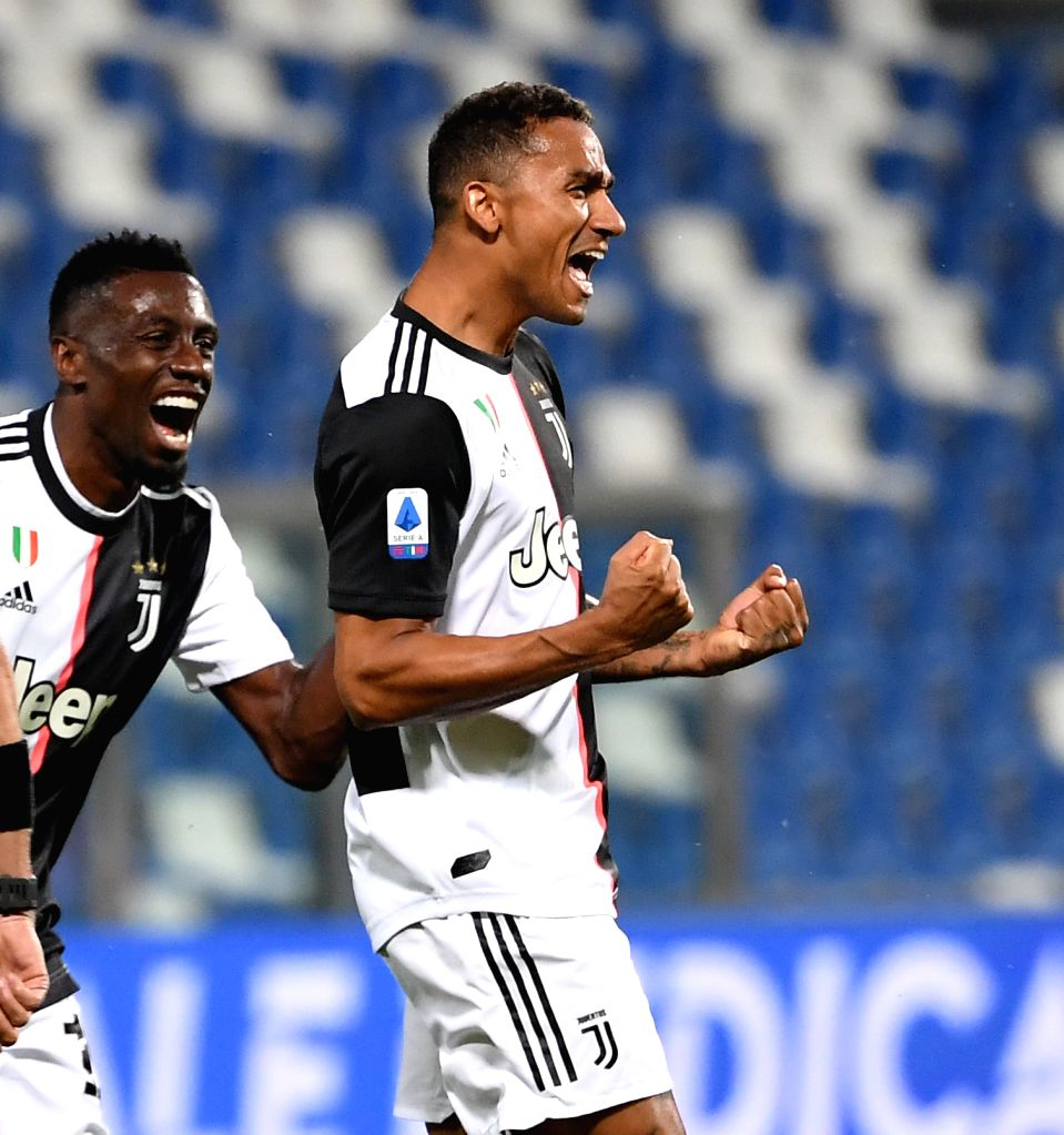 Juventus' Danilo (R) celebrates after scoring during a Serie A football match between Sassuolo and Juventus in Reggio Emilia, Italy, July 15, 2020.