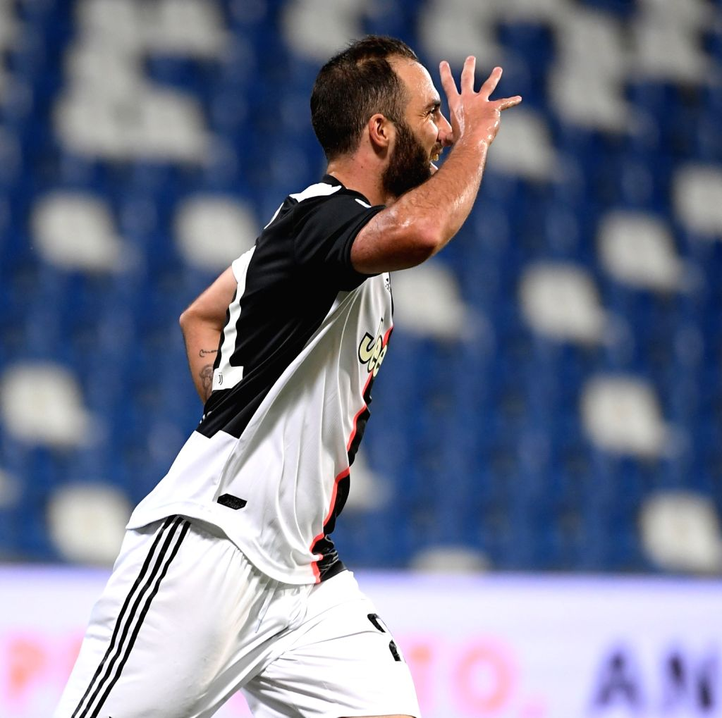 Juventus' Gonzalo Higuain celebrates after scoring during a Serie A football match between Sassuolo and Juventus in Reggio Emilia, Italy, July 15, 2020.