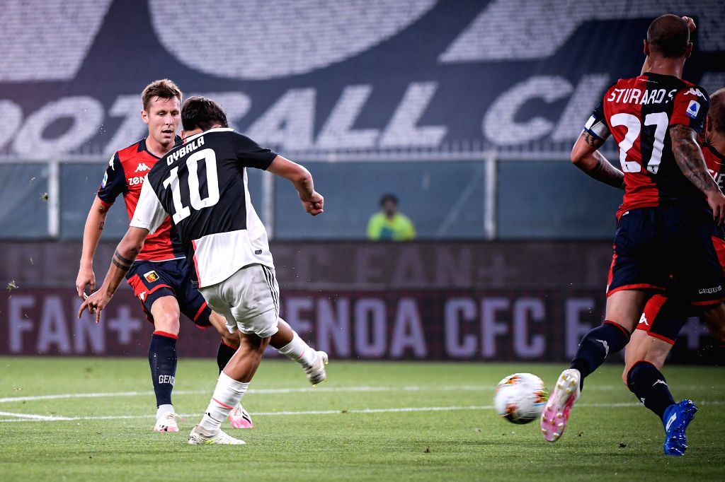 Juventus's Paulo Dybala (2nd L) scores his goal during a Serie A football match between Genoa and FC Juventus in Genova, Italy, June 30, 2020.