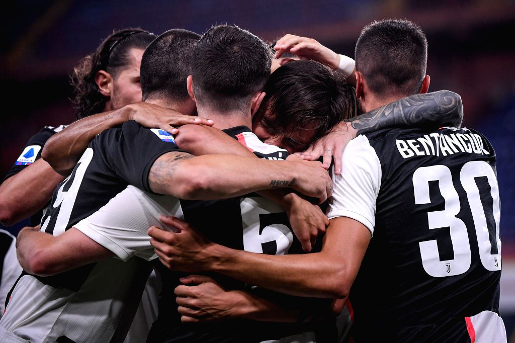 Juventus's Paulo Dybala (2nd R) celebrates his goal with his teammates during a Serie A football match between Genoa and FC Juventus in Genova, Italy, June 30, 2020.