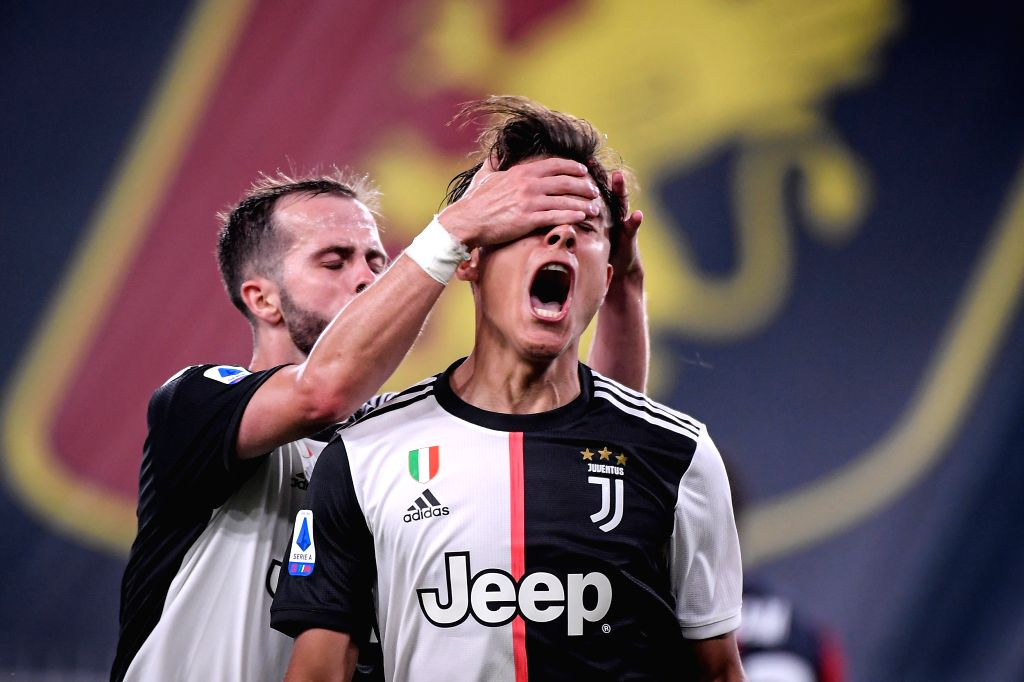 Juventus's Paulo Dybala (R) celebrates his goal with Miralem Pjanic during a Serie A football match between Genoa and FC Juventus in Genova, Italy, June 30, 2020.