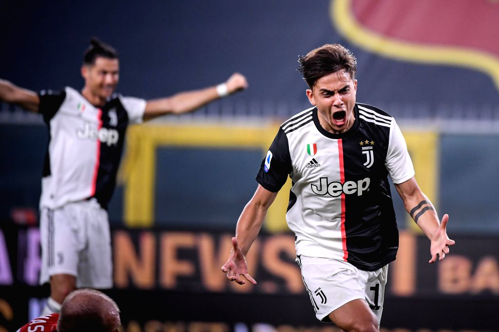 Juventus's Paulo Dybala (R) celebrates his goal during a Serie A football match between Genoa and FC Juventus in Genova, Italy, June 30, 2020.