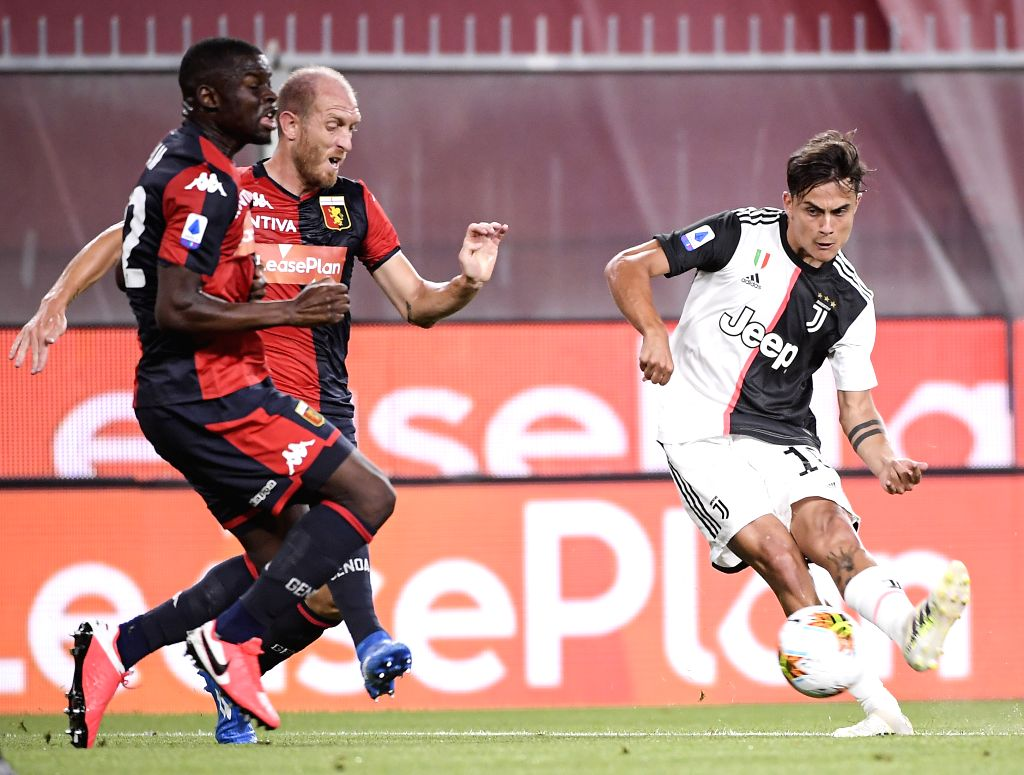 Juventus's Paulo Dybala (R) competes during a Serie A football match between Genoa and FC Juventus in Genova, Italy, June 30, 2020.